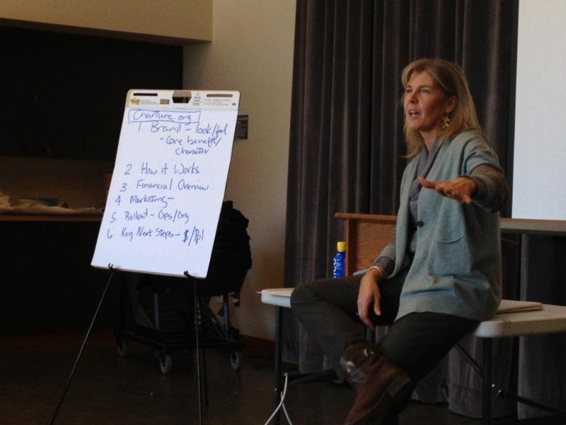 Teacher Sandy Hessler speaks to participants