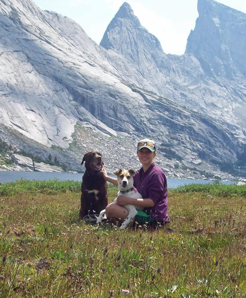 Our dogs Hunter and Dozie with my daughter Kara in the Wind River Mtns.