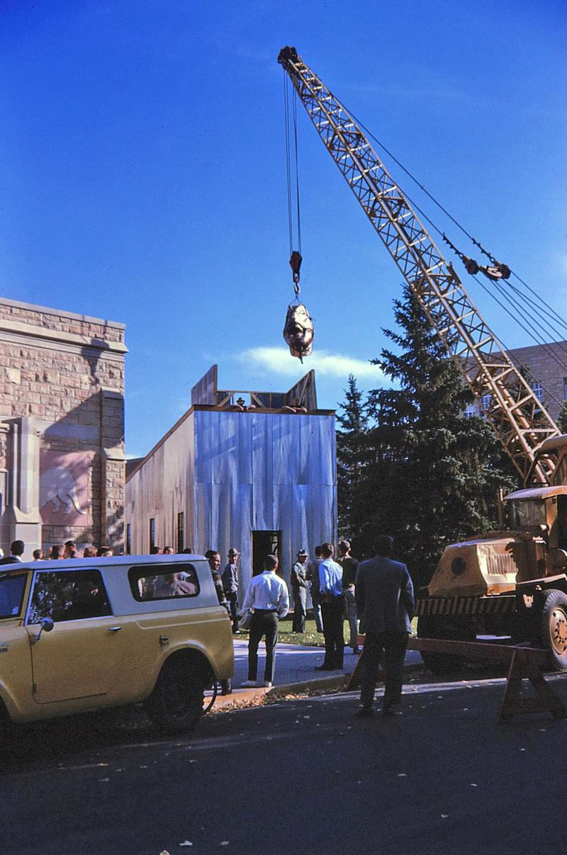 The life-sized copper statue of Tyrannosaurus rex is assembled in front of the University of Wyoming's Geological Museum in 1964.