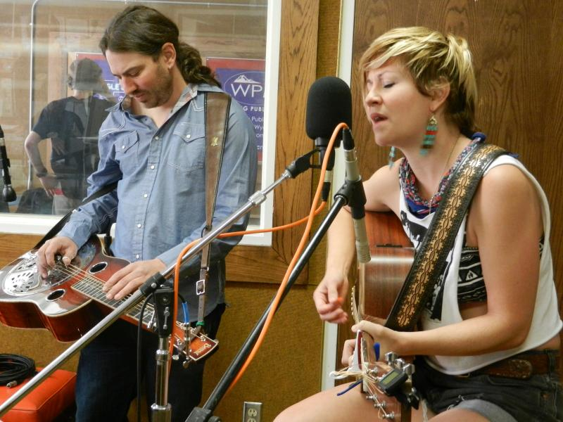 Fort Collins based band Patti Fiasco:  Ansel Foxley on dobro and Alysia Kraft on guitar and vocals.