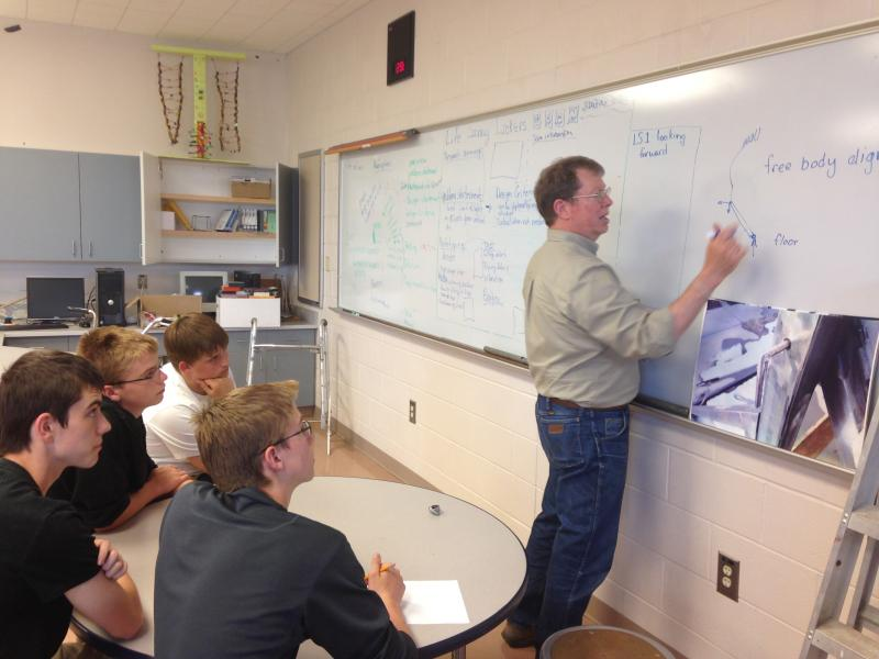 The Wheatland students get some advice on their project from Len Lutz, a lecturer at UW's College of Engineering and Applied Science.