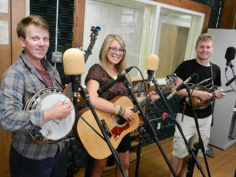 Banjo player R.P. Oates, guitarist Erinn Lukes, and mandolin player Pete Weber pose after their live set on Morning Music.