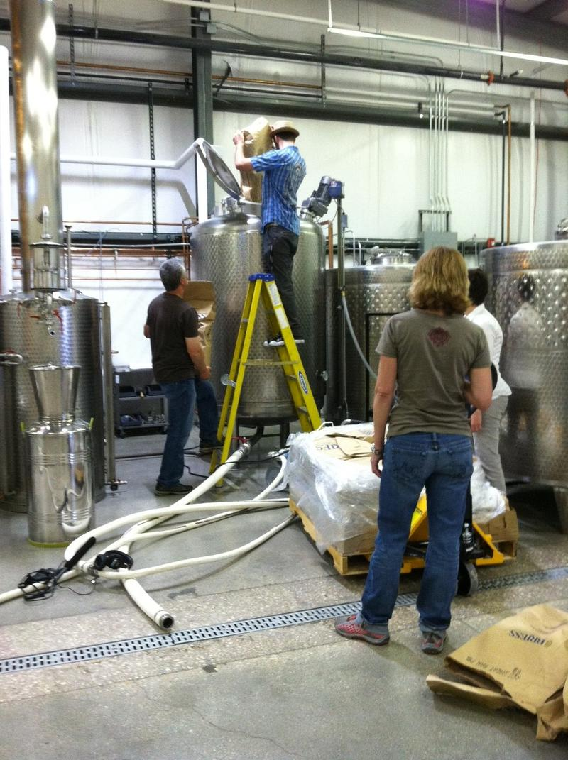 Chad Pollock and family work on making Vodka.