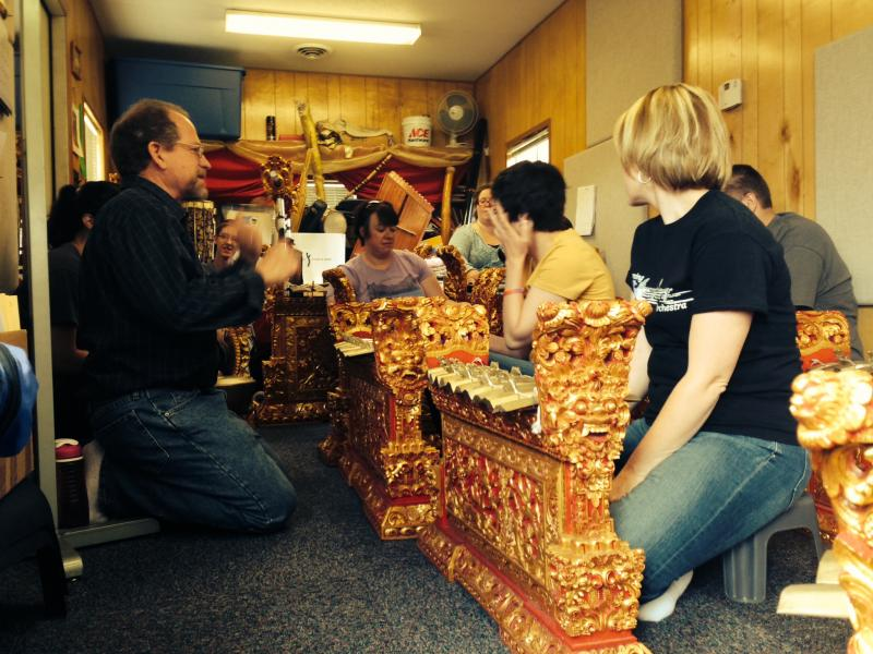 Professor Rod Garnett leads his group of graduate students in a gamelan session.