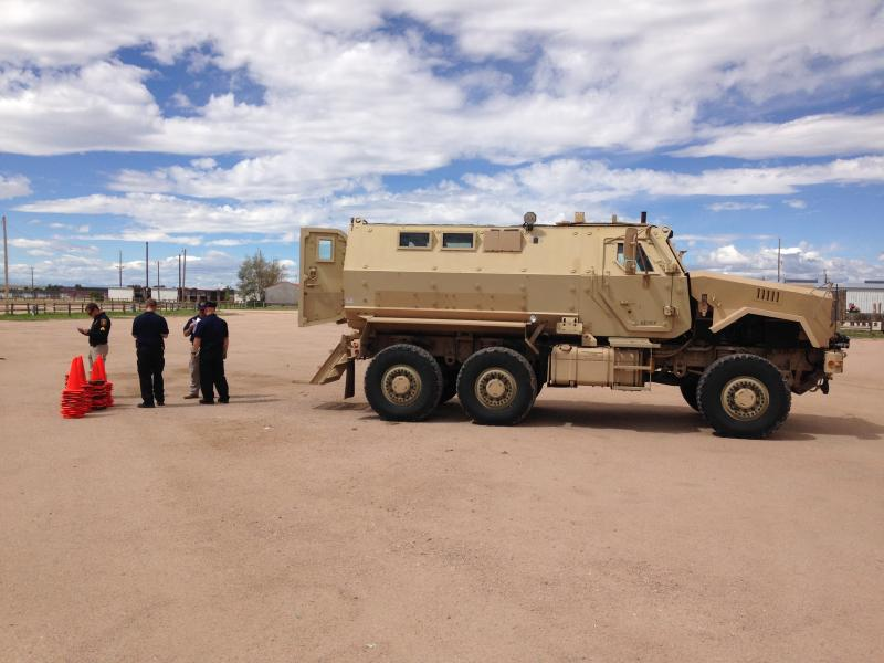 Cheyenne SWAT members setting up cones for driver's training.