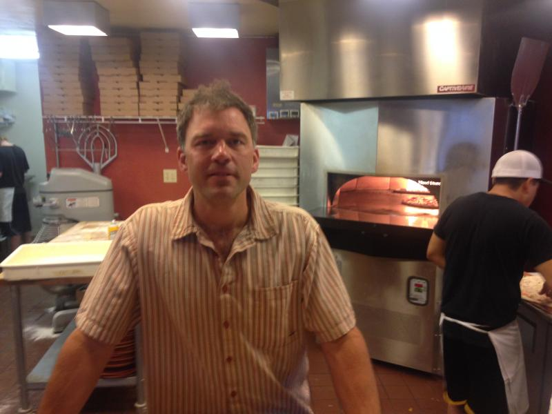 Chris Hansen at his pizza restaurant, Caldera's.