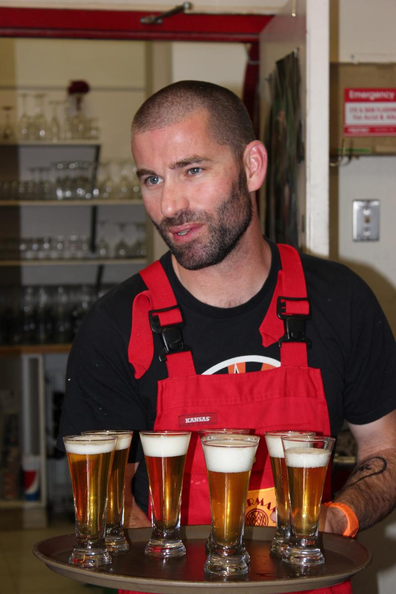 Altitude Head Brewer Jared Long brings out sample beer for the WPM staff to try.