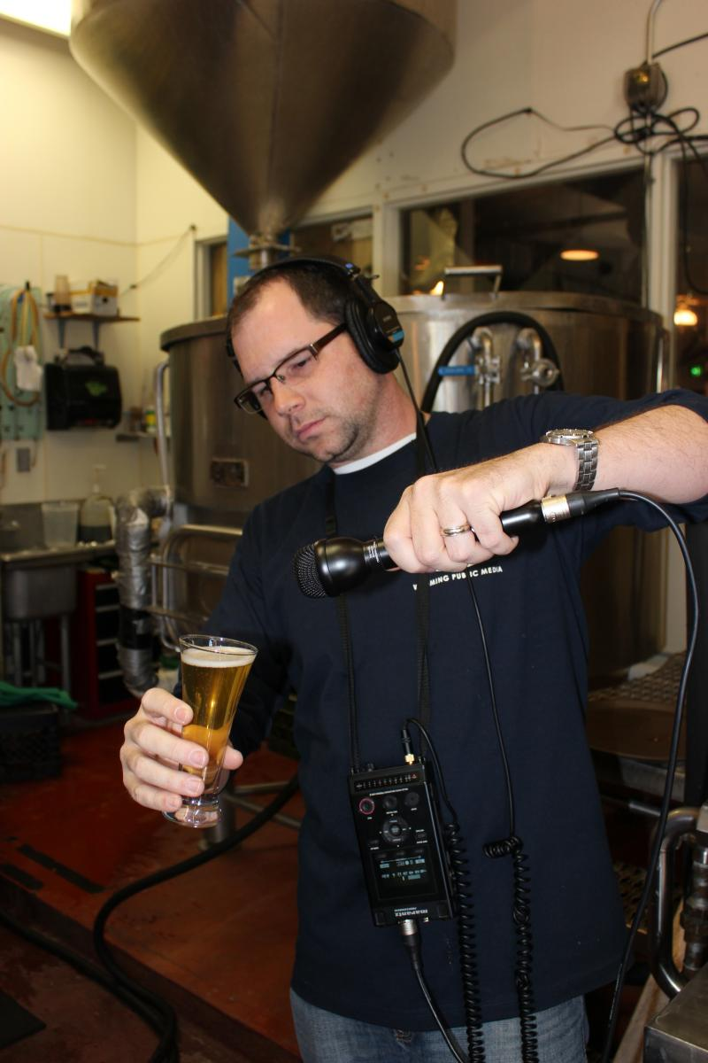 Cultural Affairs and Production Director Micah Schweizer interviews the Altitude sample beer.