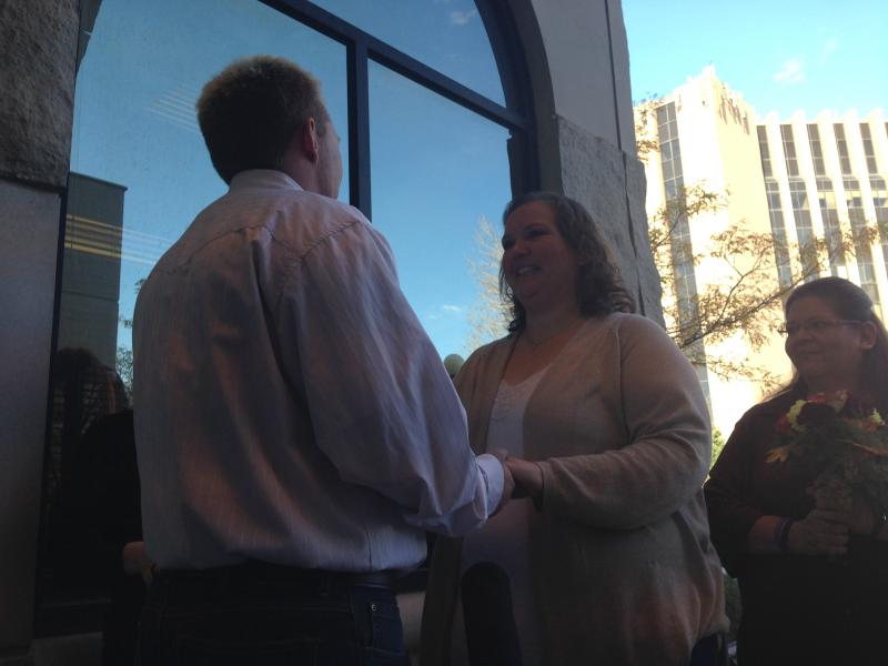 AJ McDaniel and Jennifer Mumaugh become the first same-sex couple in Laramie County to wed. McDaniel is a transgender man, but legally female, so the couple was unable to marry until Tuesday.