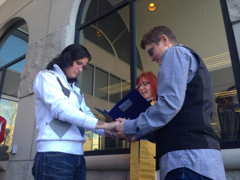 Lisa Johnson and Stacey Maloney become the second couple married in Laramie County, just minutes after county clerks around the state began issuing same-sex marriage licenses.