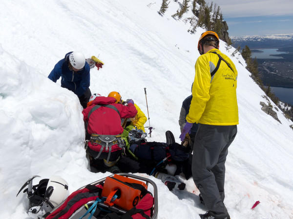 Rescuers work in steep terrain on Teewinot Mountain where a bad fall on June 4, 2011, left skier Jesse Stover with life-threatening injuries.