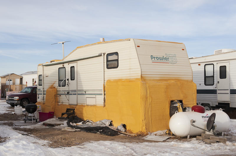 In an effort to fight North Dakota's frigid winters, one RV owner in Stanley covered their skirting in yellow spray foam insulation, effectively rendering the trailer immobile.