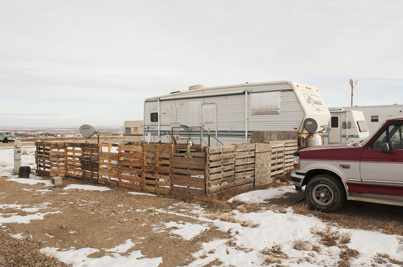 """""""I'm obsessed with shipping pallets,"""" says University of North Dakota researcher Bill Caraher. The simple wood platforms are often used in the Bakken to create stairs, walkways, and fences like this one in the Fox Run RV Park in Williston, North Dakota."""