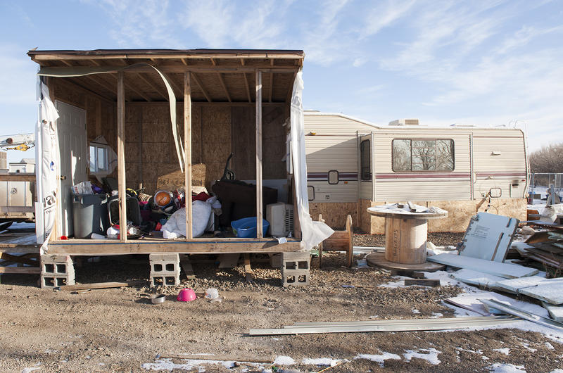 An abandoned mud room in Fox Run RV Park in Williston, North Dakota reveals toys, bedding, pet carriers, and other signs of family life left behind.