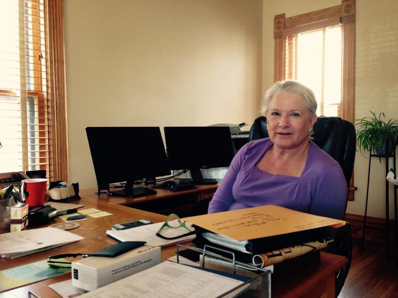 Linda Burt at her desk
