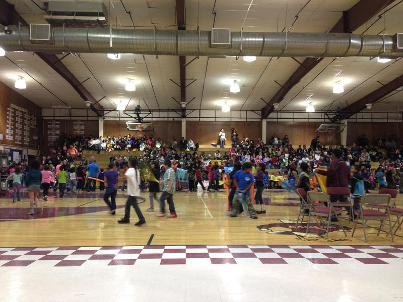 "Fort Washakie School students parade through the school's gymnasium for its annual ""Indian Days"" celebration. Each class represents a different Native American tribe."