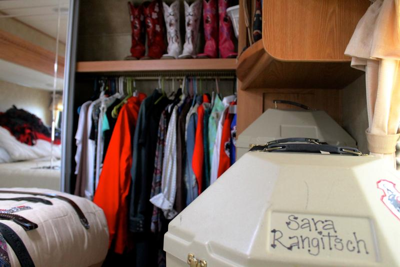 Sara Rangitsch lines up her boots, outfits, and hats in her RV at Cheyenne Frontier Days.