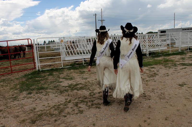 Miss Frontier Sara Rangitsch and her Lady-In-Waiting Jonna Brown check on their horses.