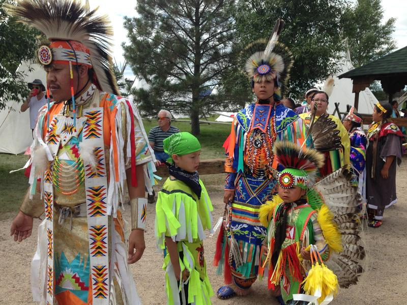 Native Americans from Wyoming's Wind River Reservation and beyond line up to show onlookers a traditional dance.