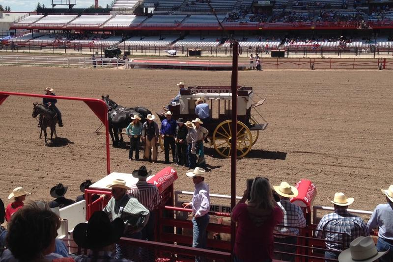 Kruse on far left in blue shirt posing pre-rodeo with an otherwise all male lineup.