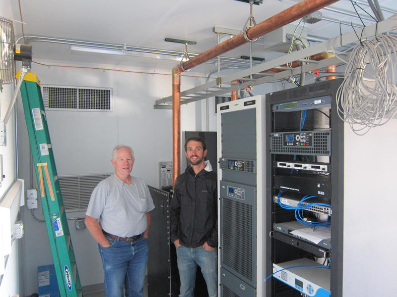 WPR Engineers Reid Fletcher and Chris Rynders in front of new KUWZ and KZUW transmitters.