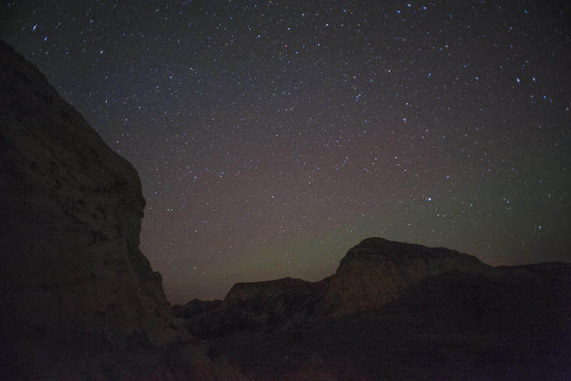 Stars shine above the Badlands south of Medora, North Dakota. At the edge of the Bakken oil field, the area suffers from less light pollution than Theodore Roosevelt National Park, twenty miles to the north.