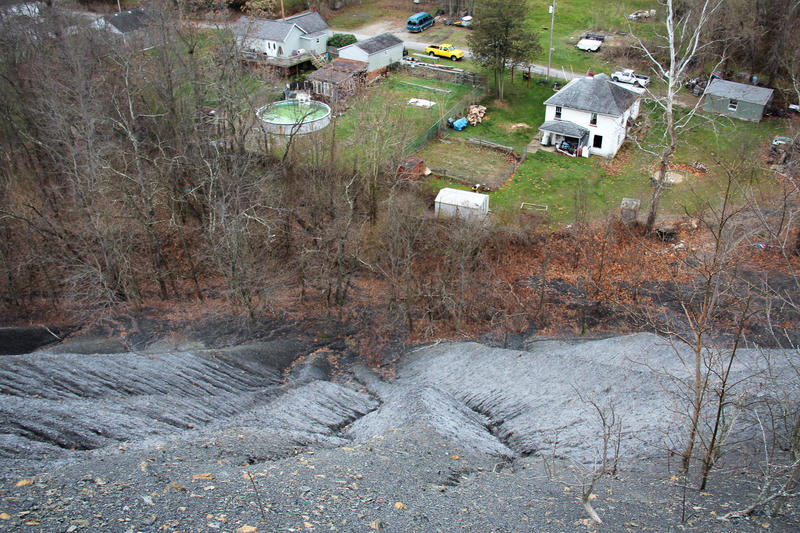 An enormous coal refuse pile hovers over the town of Fredericktown in southwestern Pennsylvania. Decades ago, companies just left piles like these behind when a mine closed. Because of this, Pennsylvania has been left with hundreds of these sites-the most