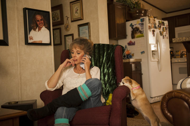 Lea Anne Shellberg in her home in Fort Collins, Colorado. A single mother who is disabled because of a work injury, Shellberg often struggles to pay her utilities on her fixed income.