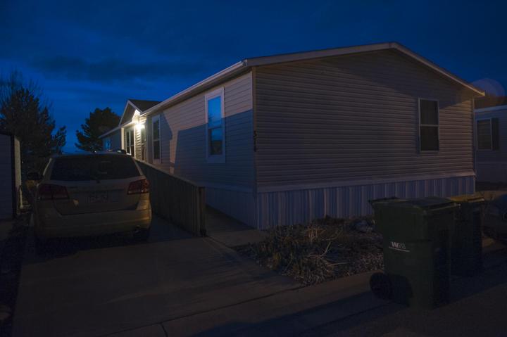 A light shines outside Shellberg's mobile home.