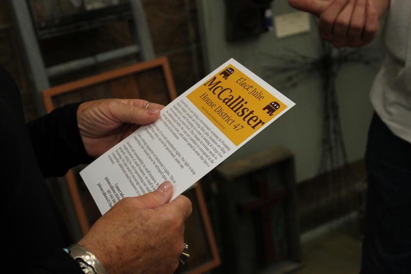 Julie McCallister hands out fliers at an art show during Saratoga Days.
