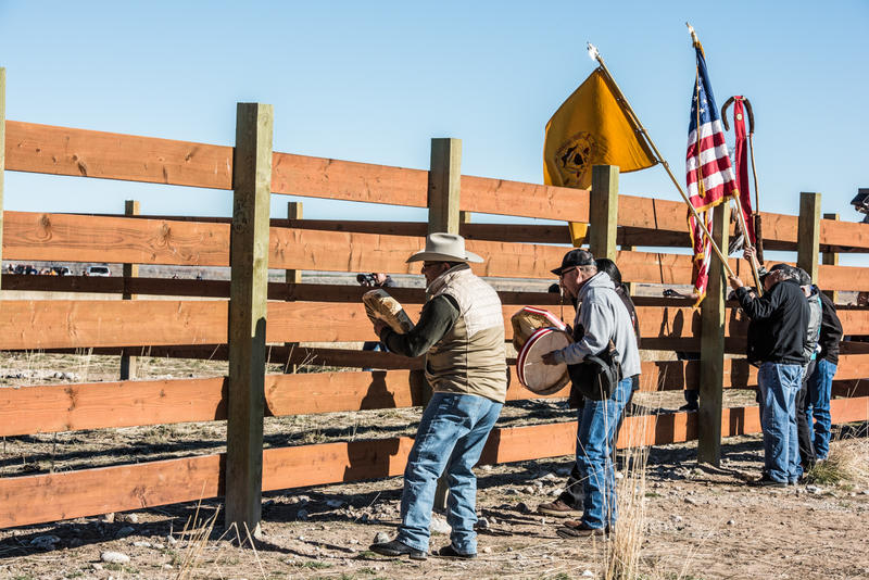 Drummers play a song to welcome the bison to their new home.