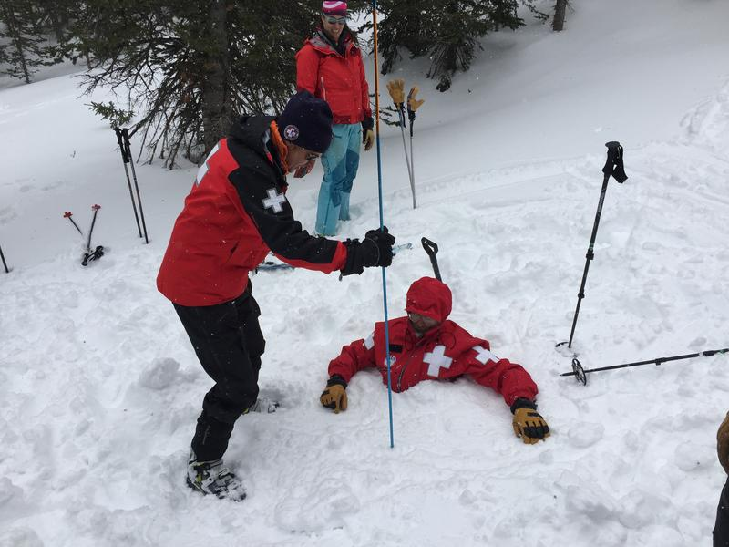 Jerry Hamman, member of the National Ski Patrol and certified avalanche instructor, buried in the snow.