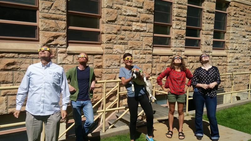 Wyoming Public Radio's News Director, Bob Beck; Sound Engineer, Ben Slater; Education Reporter, Tennessee Watson (& pup Murray); Reporter, Alanna Elder; Energy Reporter, Madelyn Beck; stare at the sun.