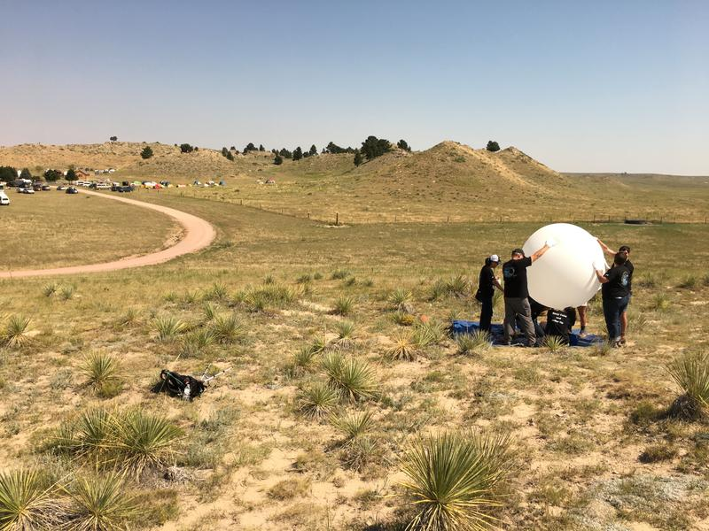 Students and staff releasing a radiosonde balloon