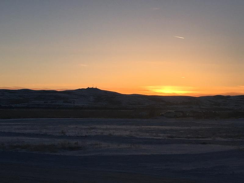 Pinedale, WY at sundown with a rig in the background