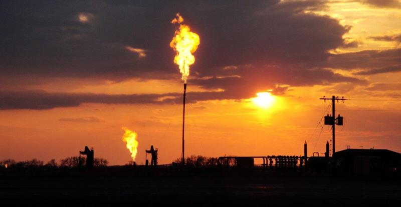 Methane is flared from a well pad in North Dakota's Bakken formation in photo taken during a 2014 NOAA research project.