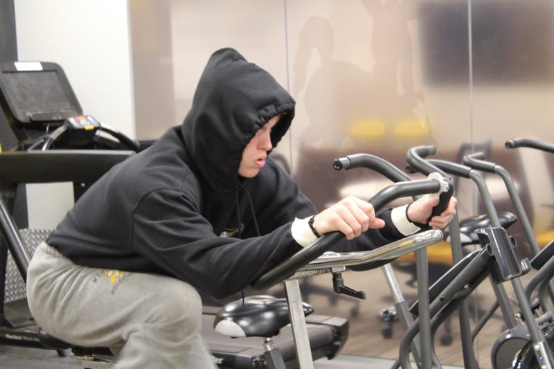Redshirt freshman Sam Turner working his weight off on the stationary bike.