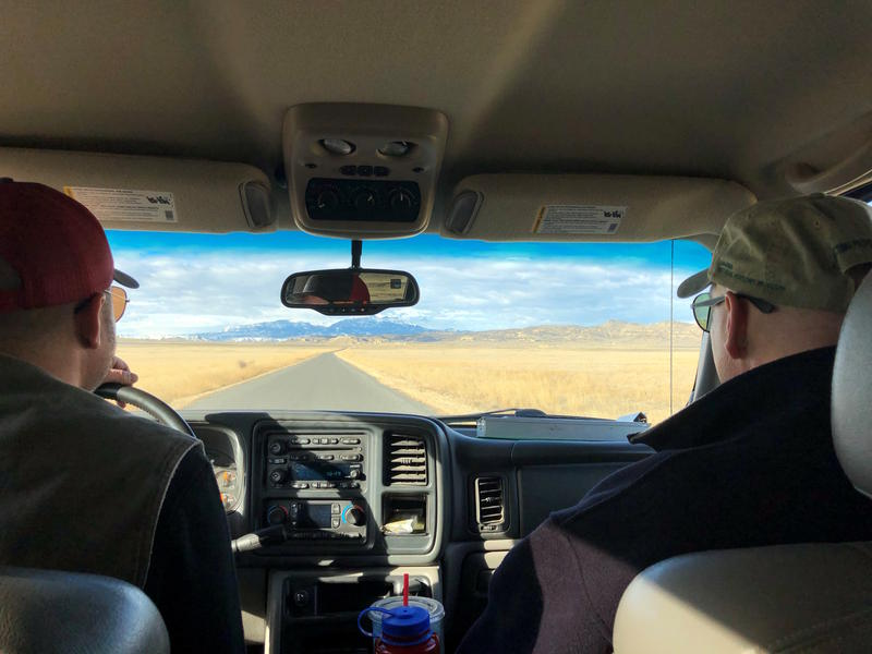 From left, Nate Horton and Charles Preston drive through the Big Horn Basin to scout golden eagle nests.
