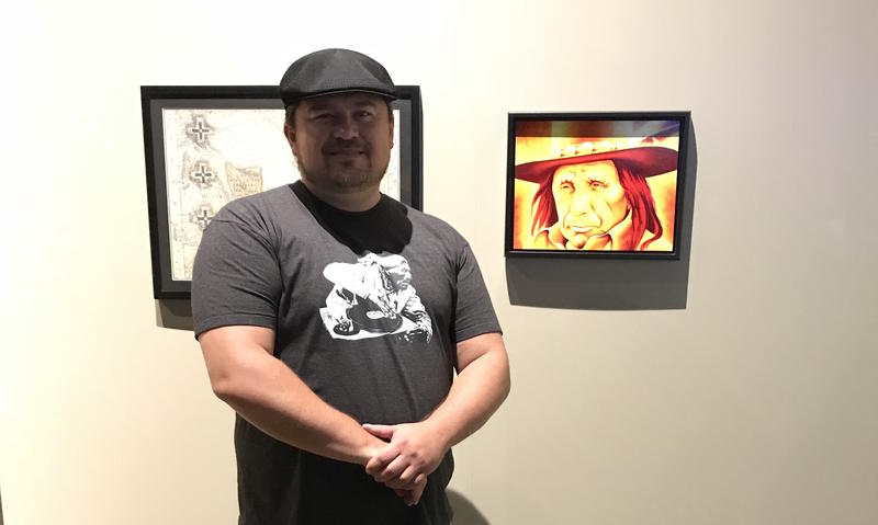 Robert Martinez stands in front of one of his artworks displayed in Native Nations Now: An Exhibition of Contemporary Native Art at the Plains Indian Museum, Buffalo Bill Center of The West.