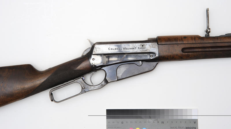 Winchester Model 1895 saddle ring carbine, serial number 22590, caliber .30, U.S. deluxe Circassian-grained, checkered stock, forend and barrel cover.