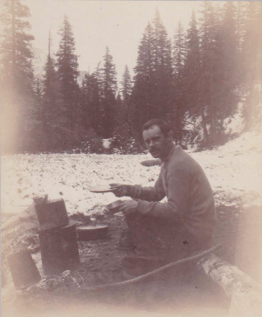 Owen Wister sitting at a campfire in 1891. Box 7, Owen Wister papers.