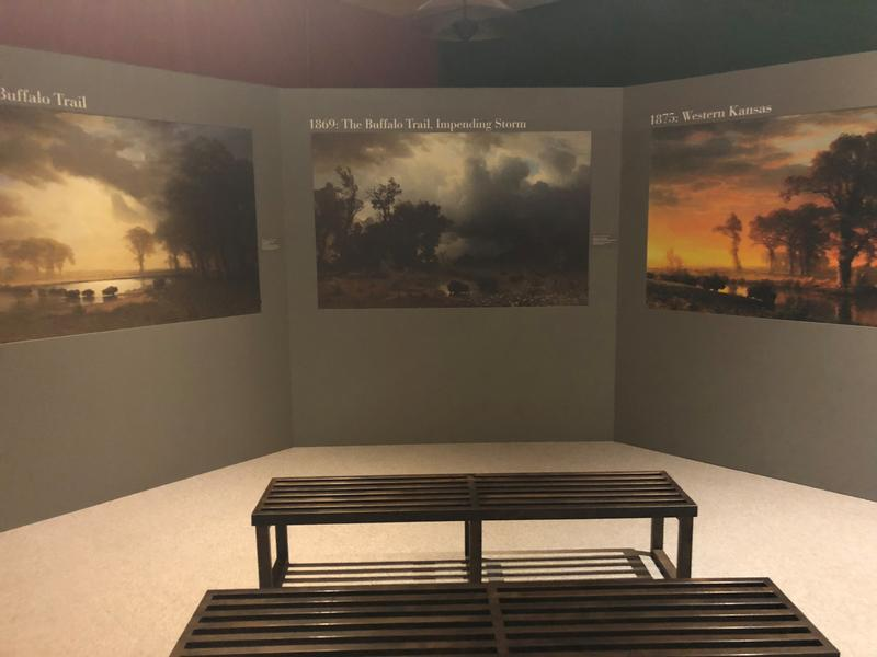 Reproductions of The Buffalo Trail  (left) and The Buffalo Trail: Impending Storm (right). Areas of the images illuminate as the narrator explores the possible messages and meanings in Bierstadt's depictions of the bison in the American West.