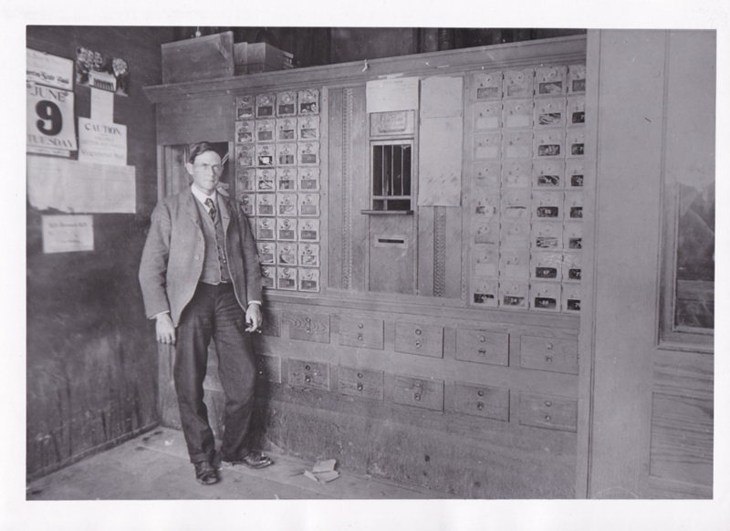 Photo of Frank Allyn in 1908 in the Riverton post office, where he was Postmaster 1907-1914. Frank Allyn Photo file.