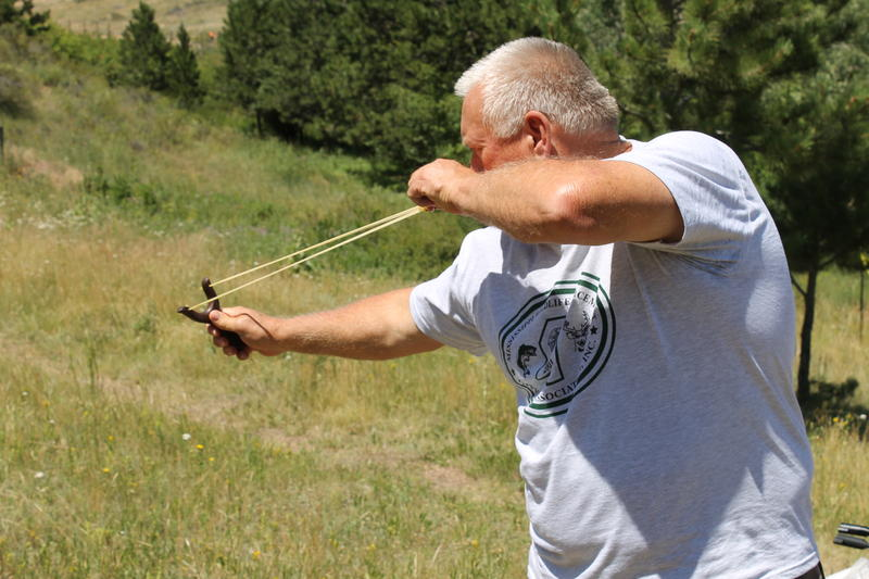 Jock Smith aims a slingshot during the target shooting competition.