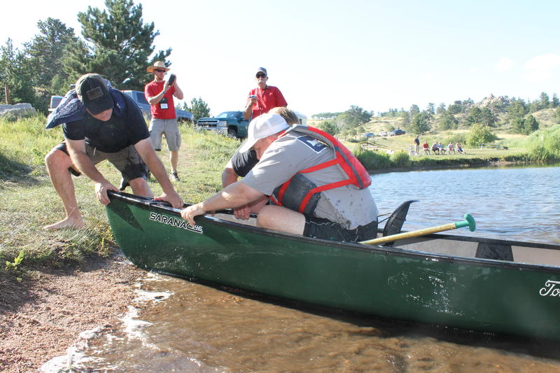 The Mississippi team pulls the canoe out of the water in the last competition.