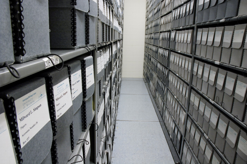 Boxes filled with archival collection material in one of the storage rooms at the American Heritage Center.