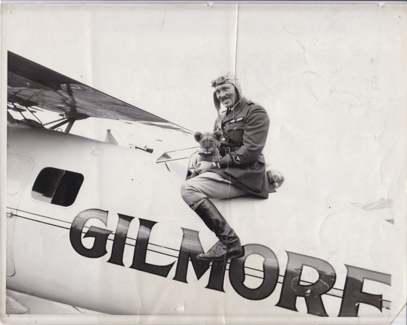 Roscoe Turner sitting on his plane and holding Gilmore the lion cub in 1929. Box 113, Roscoe Turner papers.