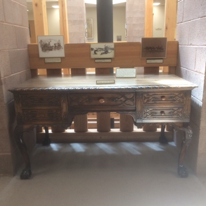 Owen Wister's writing desk on display in the Owen Wister Reading Room at the American Heritage Center.