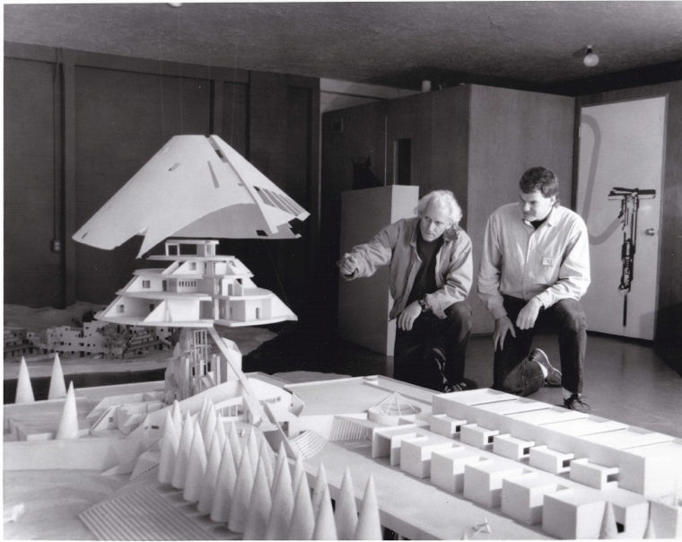 Antoine Predock, left, discussing the schematics of the Centennial Complex using a scaled, dissected model, 1989. AHC Photo Files.