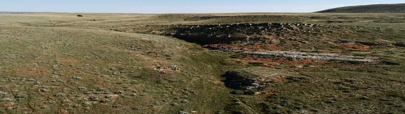 A drone's eye view of the cut bank and ridge where Surovell's team believe the mammoth is buried. Note the team at work on the bank at left center.
